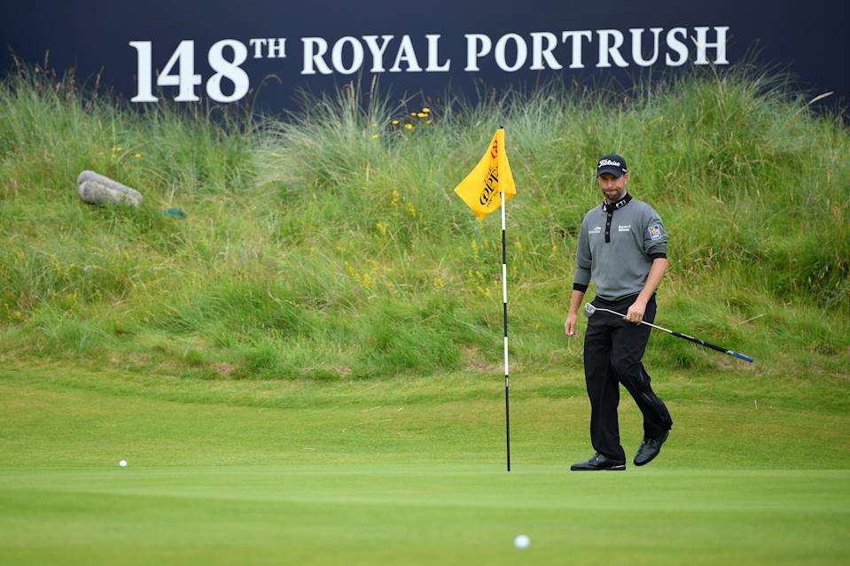 Webb Simpson of the United States takes the flag out of the 18th hole during the first round of the 148th Open Championship held on the Dunluce Links at Royal Portrush Golf Club on July 18, 2019 in Portrush, United Kingdom. (Photo by Stuart Franklin/Getty Images)
