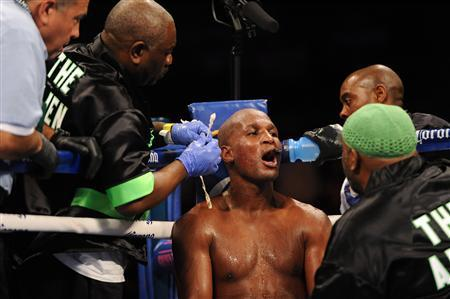 Oct 26, 2013; Atlantic City, NJ, USA; Bernard Hopkins gets worked on in his corner in between rounds during his IBF Light Heavyweight title bout against Karo Murat (not pictured) at Boardwalk Hall. Hopkins won via unanimous decision. Mandatory Credit: Joe Camporeale-USA TODAY Sports