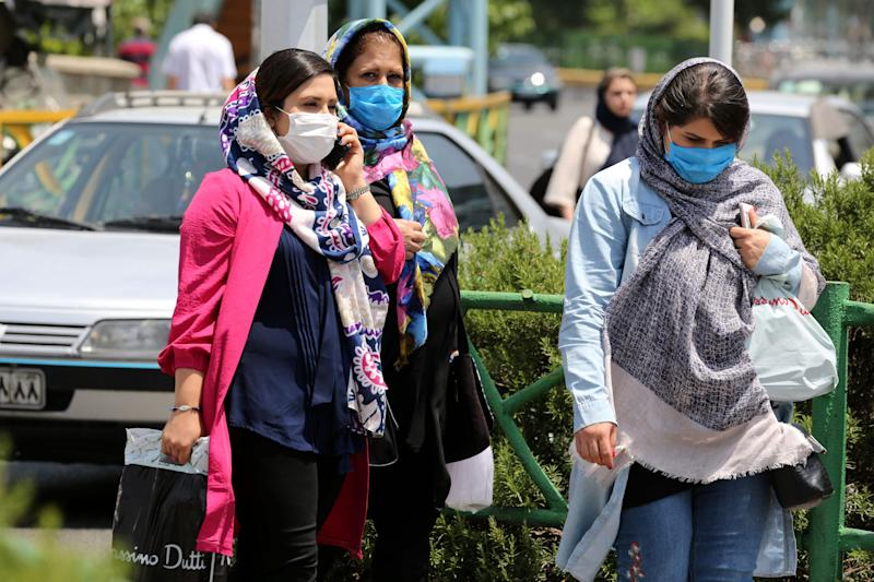 Image: Mask-wearing in Iran (Atta Kenare / AFP - Getty Images)