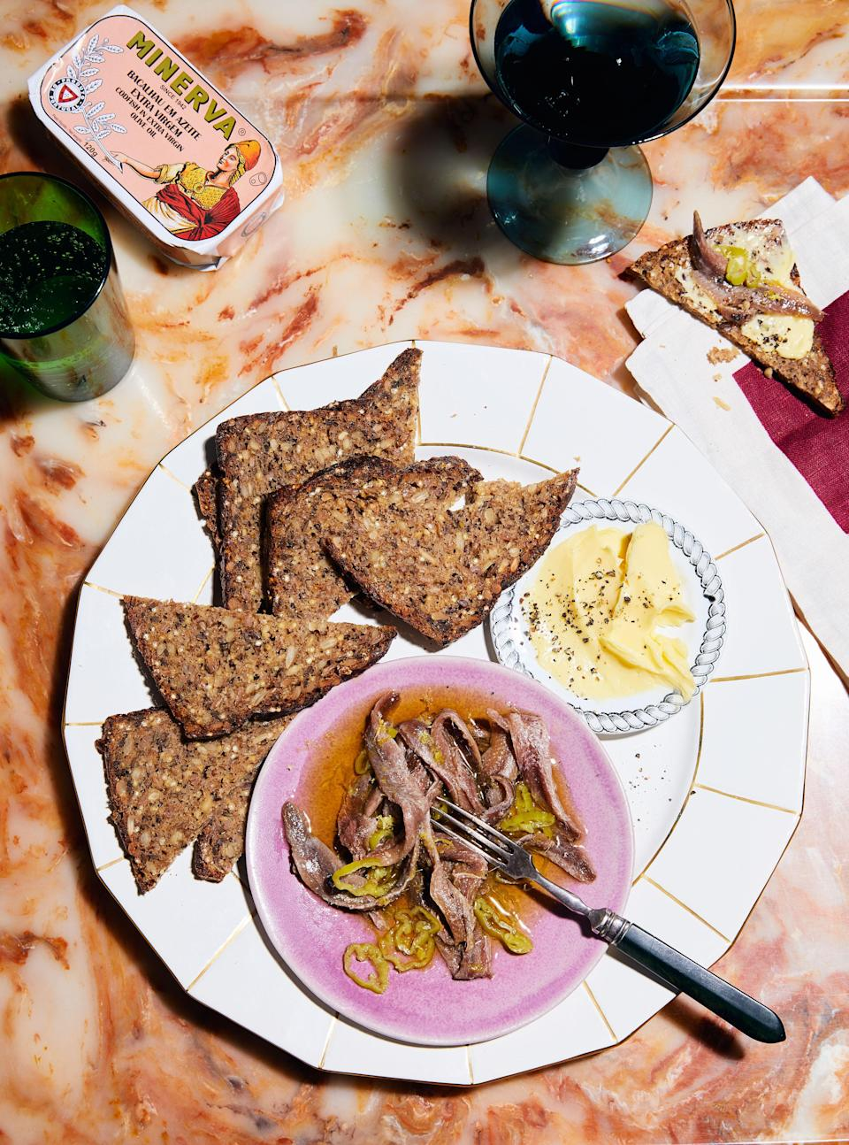 """<a href=""""https://www.bonappetit.com/recipe/marinated-anchovies-with-bread-and-butter?mbid=synd_yahoo_rss"""" rel=""""nofollow noopener"""" target=""""_blank"""" data-ylk=""""slk:See recipe."""" class=""""link rapid-noclick-resp"""">See recipe.</a>"""