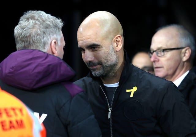 Moyes (left) was Guardiola's first managerial opponent in the Premier League in 2016