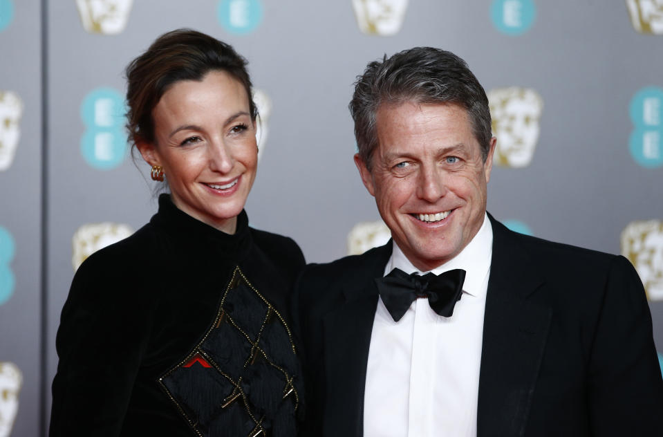 Anna Elisabet Eberstein and Hugh Grant arrives at the British Academy of Film and Television Awards (BAFTA) at the Royal Albert Hall in London, Britain, February 2, 2020. REUTERS/Henry Nicholls