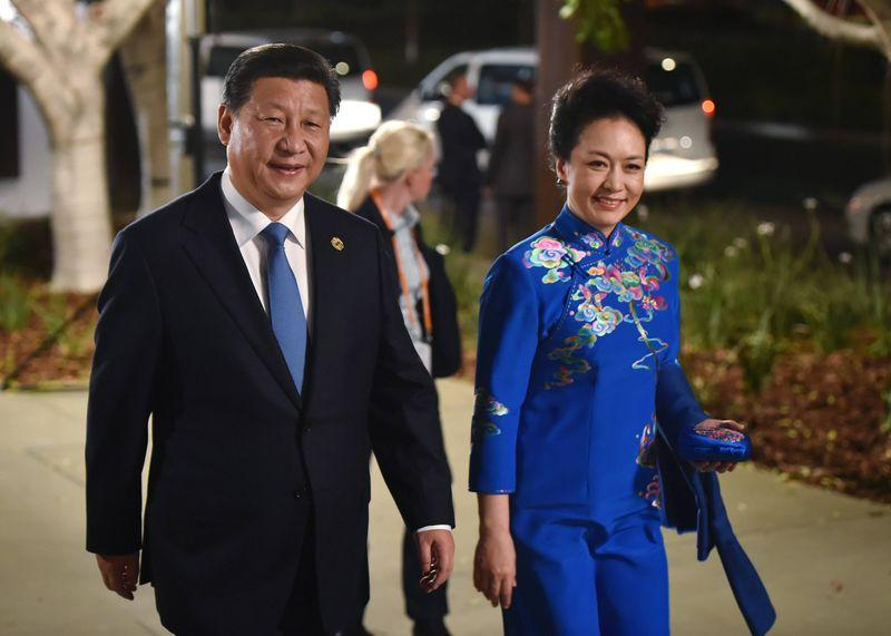 China's President Xi Jinping and his wife Peng Liyuan arrive at the Gallery of Modern Art in Brisbane as he takes part in the G20 summit