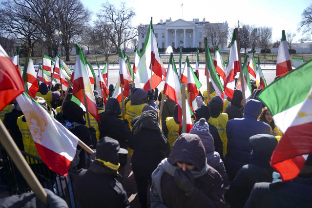 <p>Demonstrators hold Iranian flags during a rally in Lafayette Park across from the White House in Washington, on Saturday, Jan. 6, 2018, in solidarity with anti-government demonstrators in Iran. (Photo: Pablo Martinez Monsivais/AP) </p>