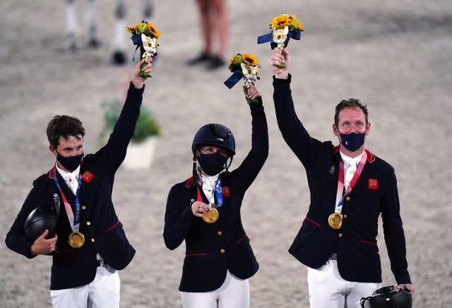 Laura Collett, Tom McEwen and Oliver Townend celebrate their gold medal