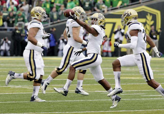 UCLA defender Randall Goforth runs off the field with the ball after recovering an Oregon fumble during the first half of an NCAA college football game in Eugene, Ore., Saturday, Oct. 26, 2013. (AP Photo/Don Ryan)