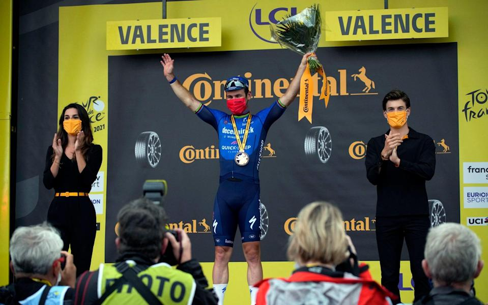 Britain's Mark Cavendish celebrates on the podium after winning the tenth stage of the Tour de France cycling race over 190.7 kilometers (118.5 miles) with start in Albertville and finish in Valence, France, Tuesday, July 6, 2021. - AP