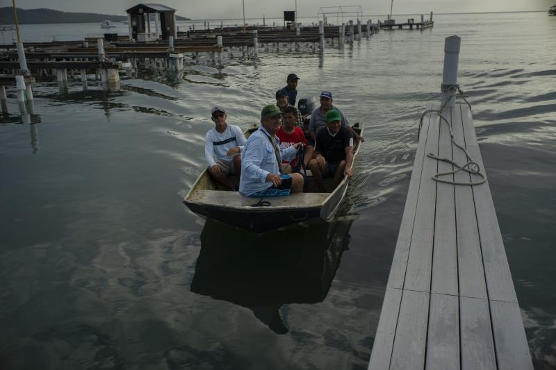 People at a harbor in Boquerón, Puerto Rico, to move boats for protection ahead of the arrival of Tropical Storm Dorian on Aug. 27. (Photo: Ramon Espinosa/AP)