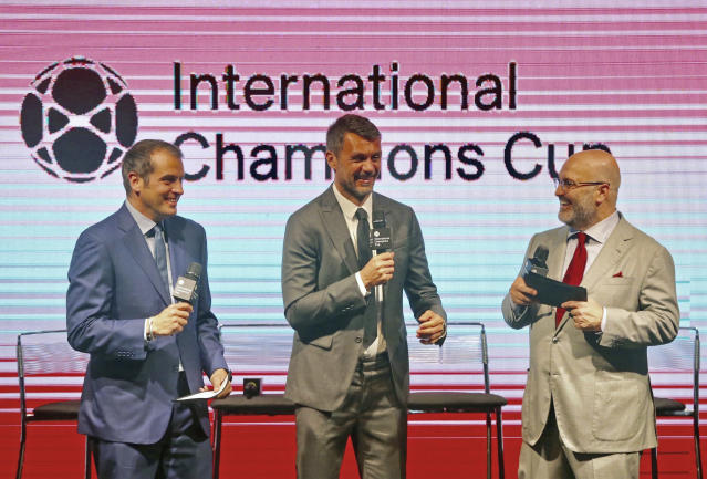 "Paolo Maldini (middle) used to play in stateside preseason friendlies, and now works as an ""ambassador"" for the International Champions Cup. Charlie Stillitano (right) is the executive chairman behind the ICC. (Getty)"