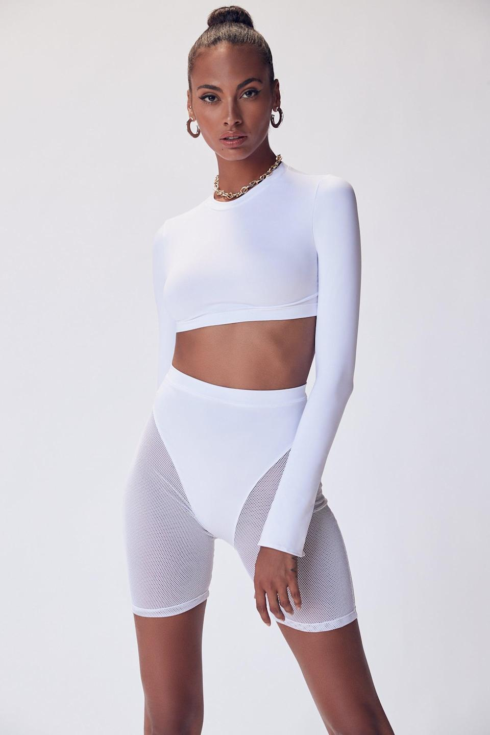 "<br> <br> <strong>LaQuan Smith x Revolve</strong> Crop Top, $, available at <a href=""https://go.skimresources.com/?id=30283X879131&url=https%3A%2F%2Fwww.revolve.com%2Flaquan-smith-x-revolve-crop-top%2Fdp%2FLAQH-WS1%2F%3Fd%3DWomens%26page%3D1%26lc%3D5%26itrownum%3D2%26itcurrpage%3D1%26itview%3D05%26hsclk12756%3D2%26hspos%3D1"" rel=""nofollow noopener"" target=""_blank"" data-ylk=""slk:Revolve"" class=""link rapid-noclick-resp"">Revolve</a> <br> <br> <strong>LaQuan Smith x Revolve</strong> Mesh Biker Short, $, available at <a href=""https://go.skimresources.com/?id=30283X879131&url=https%3A%2F%2Fwww.revolve.com%2Flaquan-smith-x-revolve-mesh-biker-short%2Fdp%2FLAQH-WF2%2F%3Fd%3DWomens%26page%3D1%26lc%3D3%26itrownum%3D1%26itcurrpage%3D1%26itview%3D05%26hsclk12756%3D2%26hspos%3D1"" rel=""nofollow noopener"" target=""_blank"" data-ylk=""slk:Revolve"" class=""link rapid-noclick-resp"">Revolve</a>"