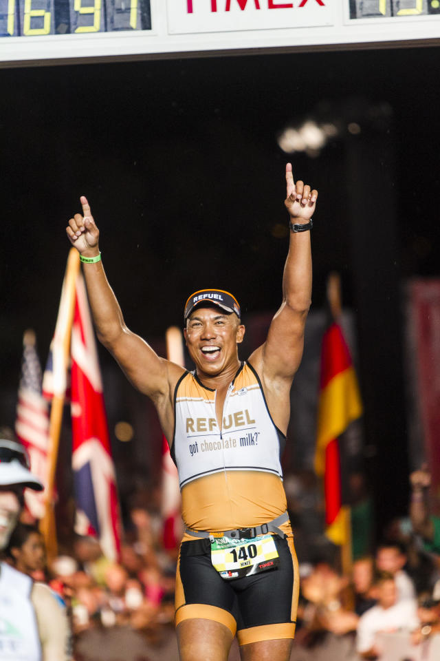 IMAGE DISTRIBUTED FOR GOPRO IRONMAN - Super Bowl Champion and BECOME ONE athlete Hines Ward crosses the finish line during the 2013 GoPro IRONMAN World Championship in Kailua-Kona, Hawaii on Saturday, Oct. 12, 2013. (Marco Garcia/AP Images for GoPro Ironman)