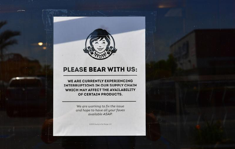 "A sign posted on a walk-in entrance to a Wendy's fast food restaurant in Alhambra, California on May 5, 2020. - A sign displayed on the walk-in entrance mentions an interruption in supply chain affecting availability of certain products. Wendy's, an international chain restaurant famous for the 1984 catchphrase ""Where's the Beef?"" is experiencing a beef shortage caused by the coronavirus pandemic, as some restaurants stop serving burgers. (Photo by Frederic J. BROWN / AFP) (Photo by FREDERIC J. BROWN/AFP via Getty Images)"