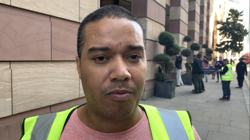 Cleaner Julian Ortiz demonstrated outside a WeWork office in London, saying he was protesting his dismissal by its cleaning firm CCM. Photo: Yahoo Finance UK / Tom Belger