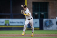 San Diego Padres shortstop Jake Cronenworth throws to first for the out on Los Angeles Dodgers' Cody Bellinger during the second inning of a baseball game Thursday, Aug. 26, 2021, in San Diego. (AP Photo/Gregory Bull)