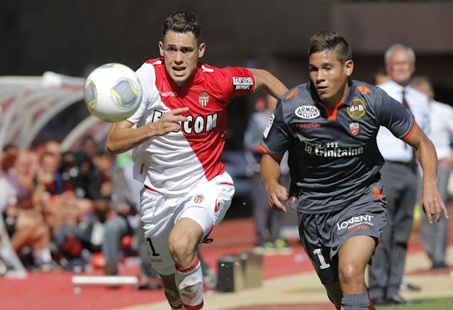 Monaco's Lucas Ocampos of Argentina, left, challenges for the ball with Lorient's Raphael Guerreiro of France during their French League One soccer match, in Monaco stadium, Sunday, Sept. 15, 2013. (AP Photo/Lionel Cironneau)