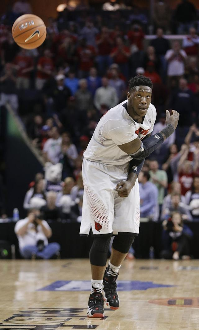 Louisville forward Montrezl Harrell slams down the ball as time expires in an NCAA college basketball game against Connecticut in the finals of the American Athletic Conference men's tournament Saturday, March 15, 2014, in Memphis, Tenn. Louisville won 71-61. (AP Photo/Mark Humphrey)
