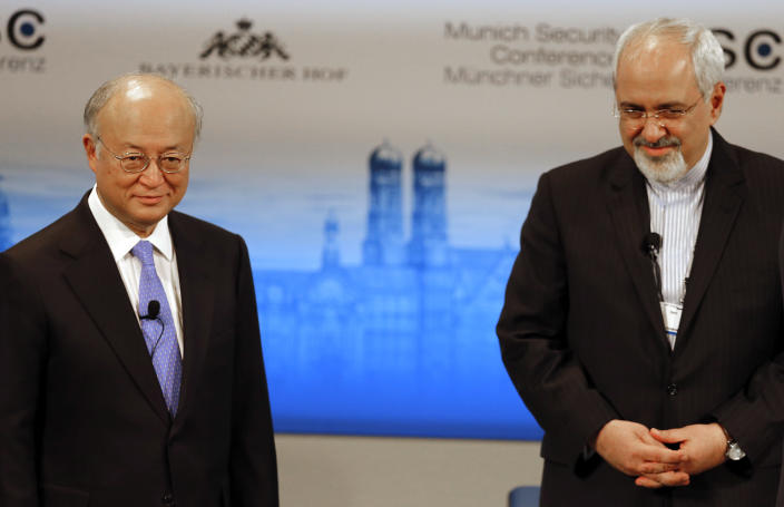 Iran's Foreign Minister Mohammad Javad Zarif, right, waits next to Director General of the International Atomic Energy Agency, IAEA, Yukiya Amano, for the start of a panel discussion at the 50th Security Conference on security policy in Munich, Germany, Sunday, Feb. 2, 2014. (AP Photo/Frank Augstein)