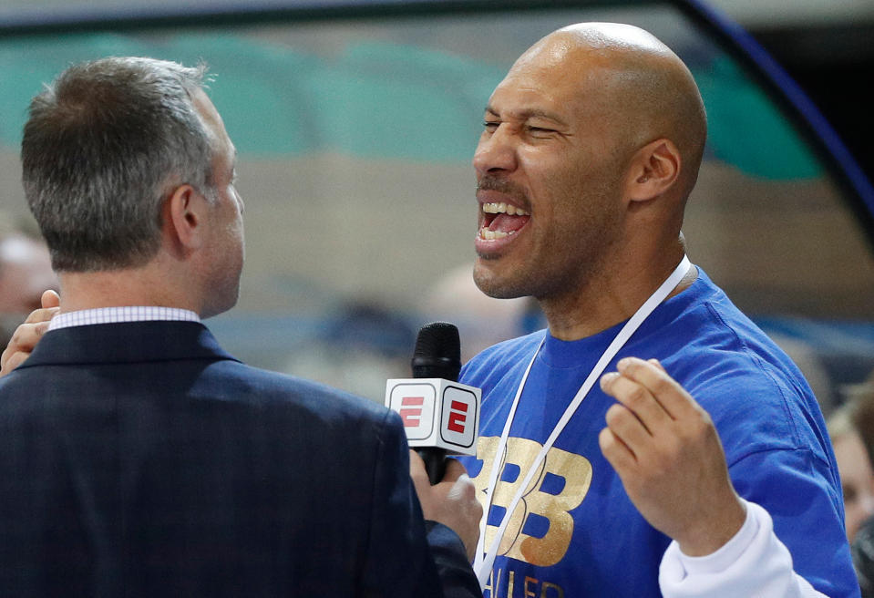 LaVar Ball is interviewed after a basketball game in Prienai, Lithuania. LiAngelo and LaMelo Ball are leaving their Lithuania team by mutual agreement. BC Prienu Vytautas on Thursday, April 26, 2018, announced the departure of the younger brothers of Los Angeles Lakers rookie Lonzo Ball. Lithuanian basketball writer Donatas Urbonas says on Twitter that father LaVar Ball told him he was upset over LaMelo's diminished playing time.(AP Photo/Liusjenas Kulbis, File)