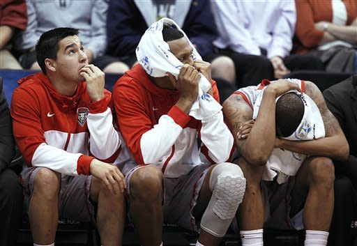 New Mexico players react on the bench as they were losing to Harvard in the second half during a second round game in the NCAA college basketball tournament in Salt Lake City Thursday, March 21, 2013. Harvard beat New Mexico 68-62. (AP Photo/George Frey)