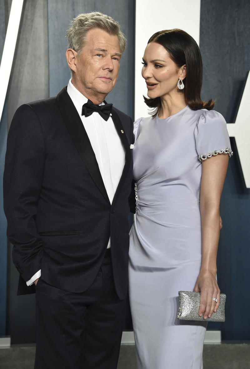 David Foster, left, and Katharine Hope McPhee Foster arrive at the Vanity Fair Oscar Party on Sunday, Feb. 9, 2020, in Beverly Hills, Calif. (Photo by Evan Agostini/Invision/AP)