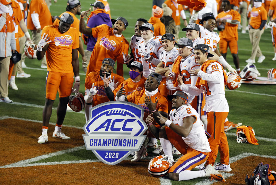 CHARLOTTE, NORTH CAROLINA - DECEMBER 19: Clemson Tigers players pose after defeating the Notre Dame Fighting Irish 34-10 in the ACC Championship game at Bank of America Stadium on December 19, 2020 in Charlotte, North Carolina. (Photo by Jared C. Tilton/Getty Images)