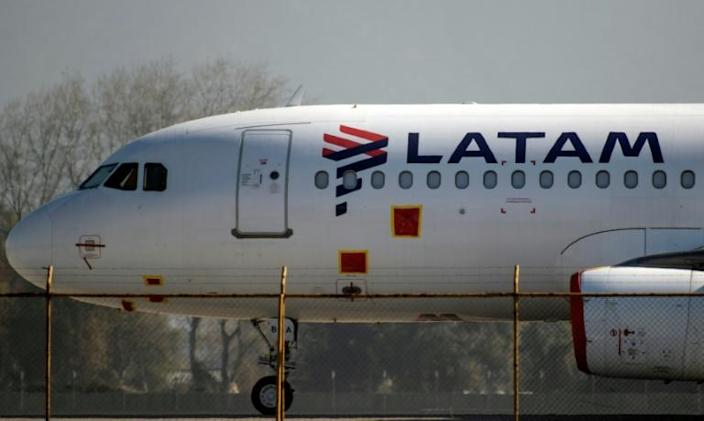 LATAM said it was laying off at least 2,700 crew (AFP Photo/MARTIN BERNETTI)