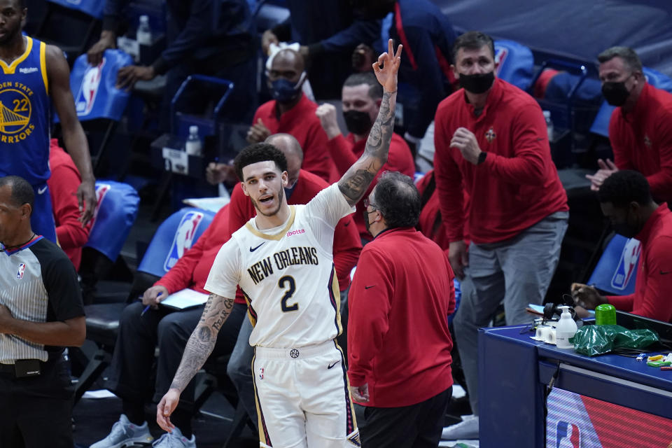 New Orleans Pelicans guard Lonzo Ball (2) reacts after making a 3-point basket at the buzzer to end the first half of an NBA basketball game against the Golden State Warriors in New Orleans, Monday, May 3, 2021. (AP Photo/Gerald Herbert)