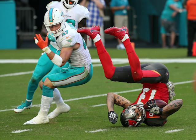 <p>Miami Dolphins' Kiko Alonso (47) watches Tampa Bay Buccaneers' Mike Evans roll on the field after a reception in the first quarter on Sunday, Nov. 19, 2017 at Hard Rock Stadium in Miami Gardens, Fla. (Charles Trainor Jr./Miami Herald/TNS) </p>