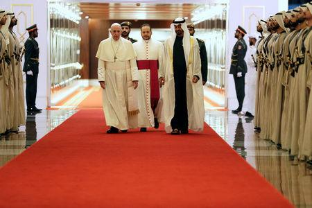 Pope Francis is welcomed by Abu Dhabi's Crown Prince Mohammed bin Zayed Al-Nahyan in Abu Dhabi