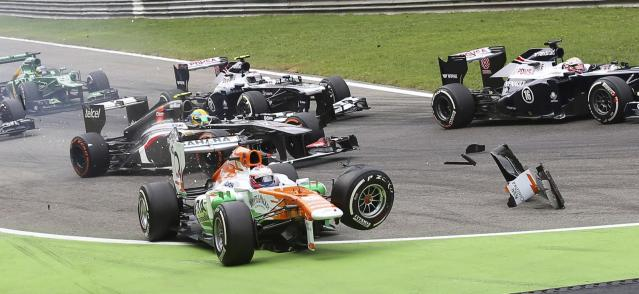 Force India Formula One driver Paul di Resta of Britain loses his front wheel after a collision with Lotus F1 Formula One driver Romain Grosjean (not pictured) of France at the start of the Italian F1 Grand Prix at the Monza circuit September 8, 2013. Resta retired from the race after the incident. REUTERS/Enrico Schiavi (ITALY - Tags: SPORT MOTORSPORT F1 TPX IMAGES OF THE DAY)