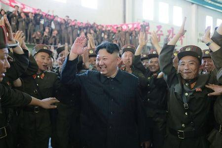 North Korean leader Kim Jong Un reacts with scientists and technicians of the DPRK Academy of Defence Science after the test-launch of the intercontinental ballistic missile Hwasong-14 in this undated photo released by North Korea's Korean Central News Agency (KCNA) in Pyongyang July 5, 2017. KCNA/via REUTERS/Files