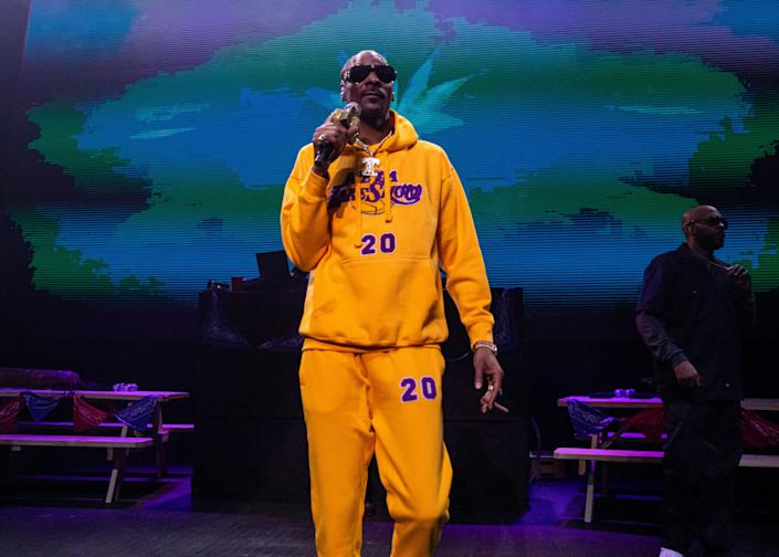 Snoop Dogg wears a Lakers sweatsuit during a performance in Detroit on Jan. 26.