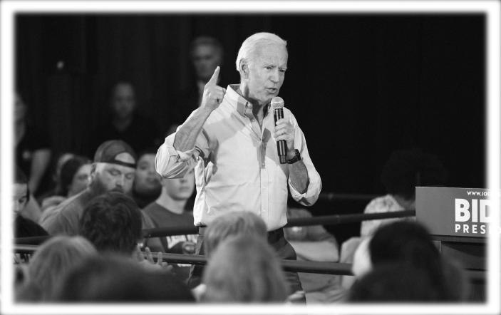 Joe Biden at Clinton Community College in Iowa in June. (Photo: Charlie Neibergall/AP; digitally enhanced by Yahoo News)