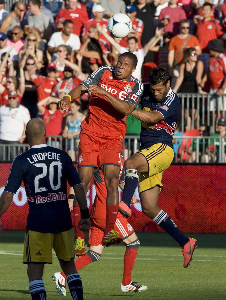 Toronto FC Ryan Johnson heads the ball against New York Red Bulls Wilman Conde, right, during first half MLS soccer action in Toronto on Saturday June 30, 2012. THE CANADIAN PRESS/Aaron Vincent Elkaim