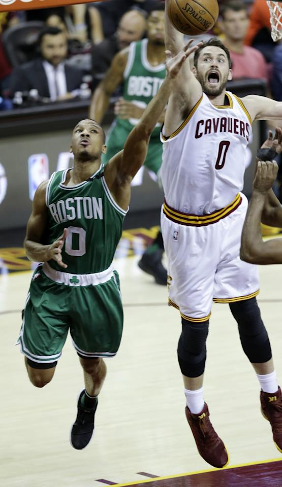 <p>Boston Celtics' Avery Bradley (0) shoots against Cleveland Cavaliers' Kevin Love (0) during the first half of Game 4 of the NBA basketball Eastern Conference finals, Tuesday, May 23, 2017, in Cleveland. (AP Photo/Tony Dejak) </p>