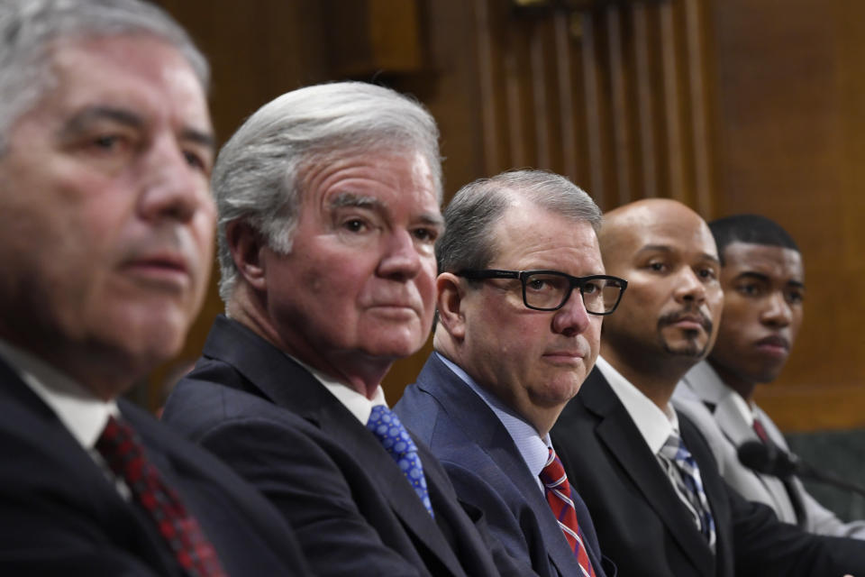 FILE - In this Feb. 11, 2020, file photo, a panel of witnesses, from left, Big 12 Conference Commissioner Bob Bowlsby, National Collegiate Athletic Association President Mark Emmert, University of Kansas Chancellor Dr. Douglas Girod, National College Players Association Executive Director Ramogi Huma and National Collegiate Athletic Association Student-Athlete Advisory Committee Chair Kendall Spencer, listen during a Senate Commerce subcommittee hearing on intercollegiate athlete compensation on Capitol Hill in Washington. College sports is entering a new era: Athletes will be permitted to be paid endorsers and social media influencers without fear of running afoul of NCAA rules. (AP Photo/Susan Walsh, File)