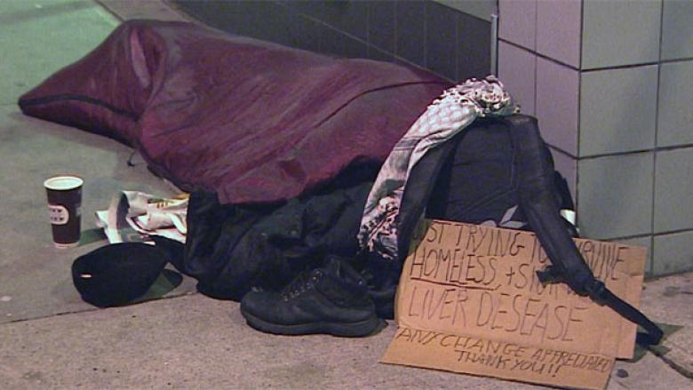 A homeless person covers up for the night in downtown Vancouver during a cold snap in December.