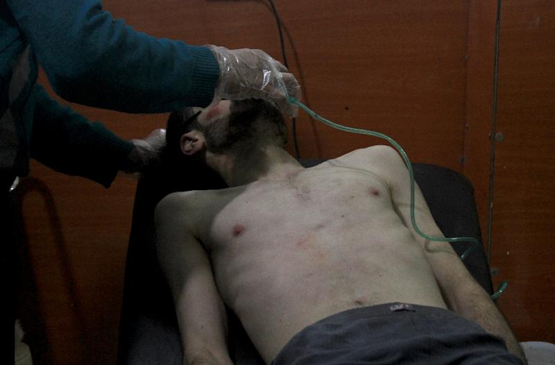 A Syrian man is treated at a field hospital after a 2014 alleged gas attack by pro-regime troops on the rebel-held city of Daraya (AFP Photo/Fadi Dirani)