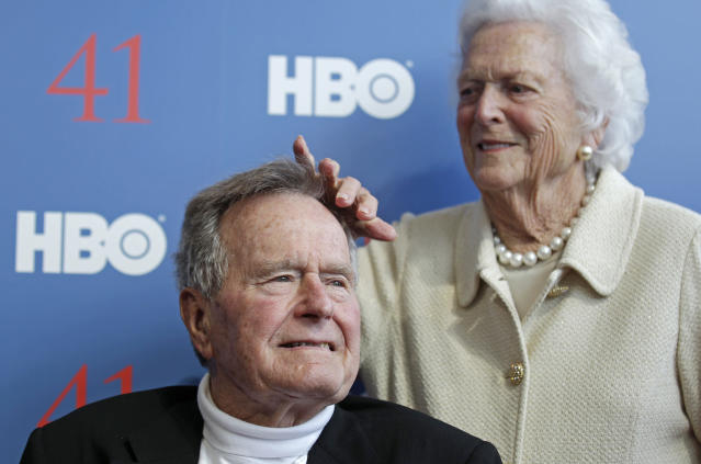 """Former first lady Barbara Bush touches the hair of her husband President George H.W. Bush as they arrive for the premiere of HBO's new documentary on his life in Kennebunkport, Maine, Tuesday, June 12, 2012. The premiere of """"41"""" was held Tuesday on Bush's 88th birthday on the grounds of St. Ann's Church in Kennebunkport, near the Bush family's summer home.(AP Photo/Charles Krupa)"""