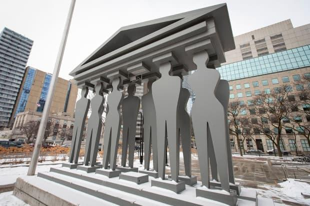 Monuments to the Canadian justice system are pictured near the Ontario Court of Justice on Feb. 12, 2021. (Evan Mitsui/CBC - image credit)