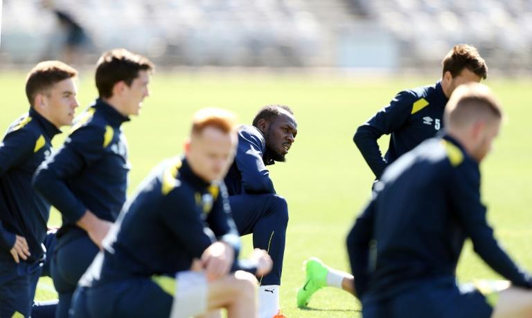 "Usain Bolt (C) said he wanted to be treated ""as one of the boys"" as he trains for the first time for A-League football club Central Coast Mariners"