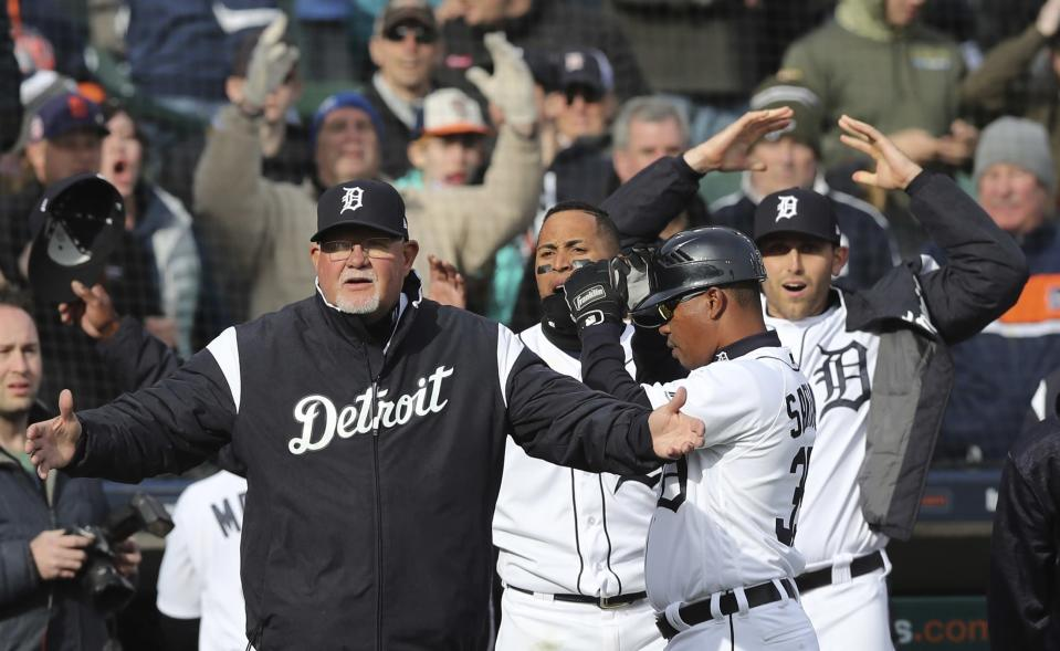 The Detroit Tigers react after a review of a play was overturned during the 10th inning of a baseball game against the Pittsburgh Pirates, Friday, March 30, 2018, in Detroit. Tigers' Nicholas Castellanos was initially called safe at home. (AP Photo/Carlos Osorio)