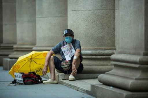 A pro-democracy sits outside Hong Kong's Court of Final Appeal