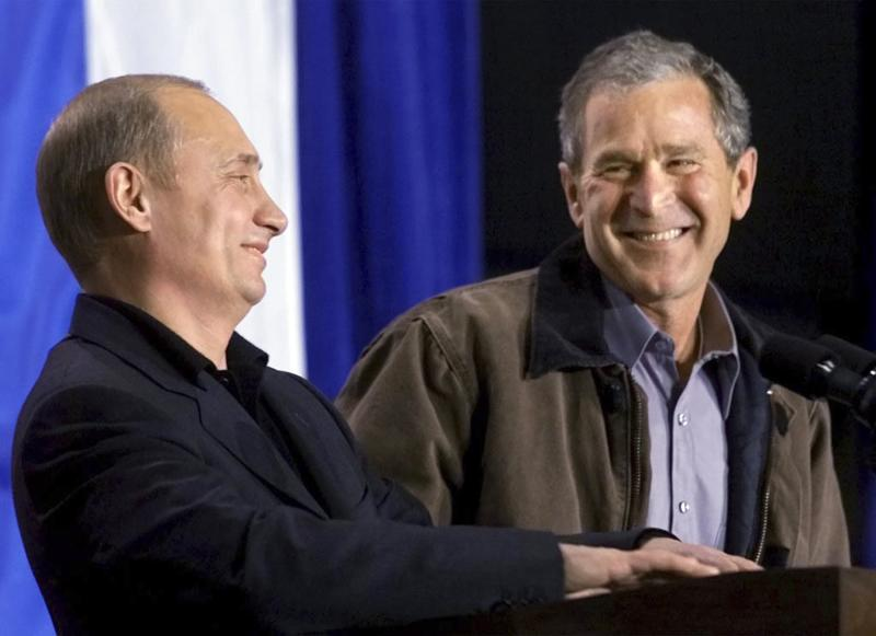 U.S. President George W. Bush shares a laugh with Russian President Vladimir Putin as the two answer questions at the Crawford High School in Crawford, Texas, in this November 15, 2001 file photo. To match Special Report UKRAINE-PUTIN/DIPLOMACY REUTERS/Win McNamee/Files (UNITED STATES - Tags: POLITICS)