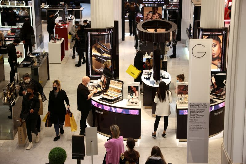 FILE PHOTO: People shop in the Selfridges department store on Oxford street in London