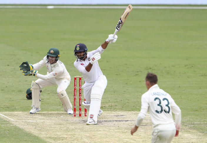India's Shardul Thakur bats during play on day three of the fourth cricket test between India and Australia at the Gabba, Brisbane, Australia, Sunday, Jan. 17, 2021. (AP Photo/Tertius Pickard)