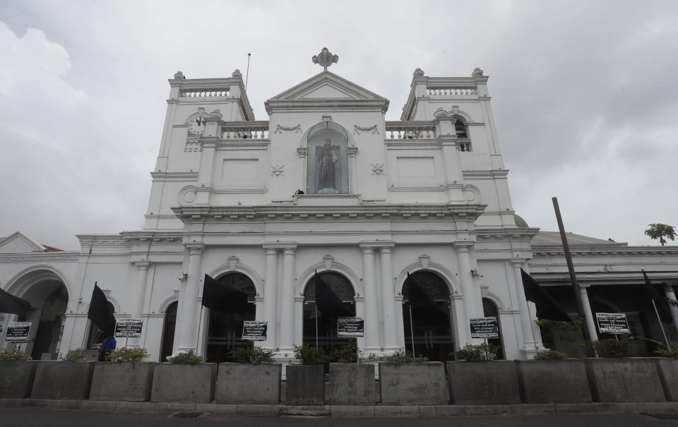 Black flags are seen in front of St. Anthoney's Church, in Colombo, Sri Lanka, Saturday, Aug. 21, 2021. Sri Lankan Catholics hoisted black flags in churches and at homes on Saturday protesting against what they call government's inaction to find the true conspirators in the Easter Sunday blasts of 2019 which killed 269 people. (AP Photo/Eranga Jayawardena)