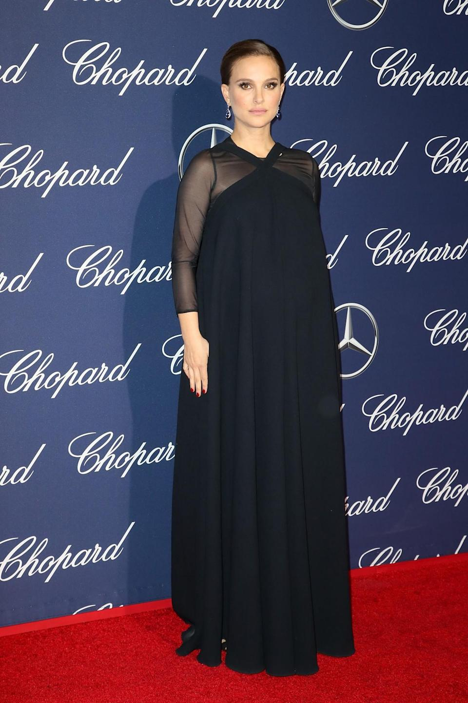 <p>Portman kept her baby bump covered in a full length midnight blue dress. [Photo: Getty] </p>