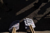 Signs sit on the ground before a rally calling for every vote to be counted from yesterday's general election near the Detroit Department of Elections building in Detroit, Mich., Wednesday, Nov. 4, 2020. (AP Photo/David Goldman)