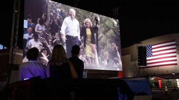 PHOTO: People listen to the Democratic National Convention being broadcast in a parking lot outside Chase Center in Wilmington, Del., Aug. 20, 2020. (Alex Wong/Getty Images)